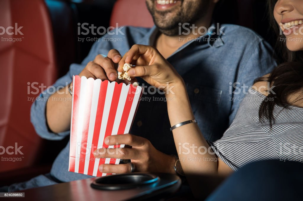 Eating popcorn at the movie theater stock photo