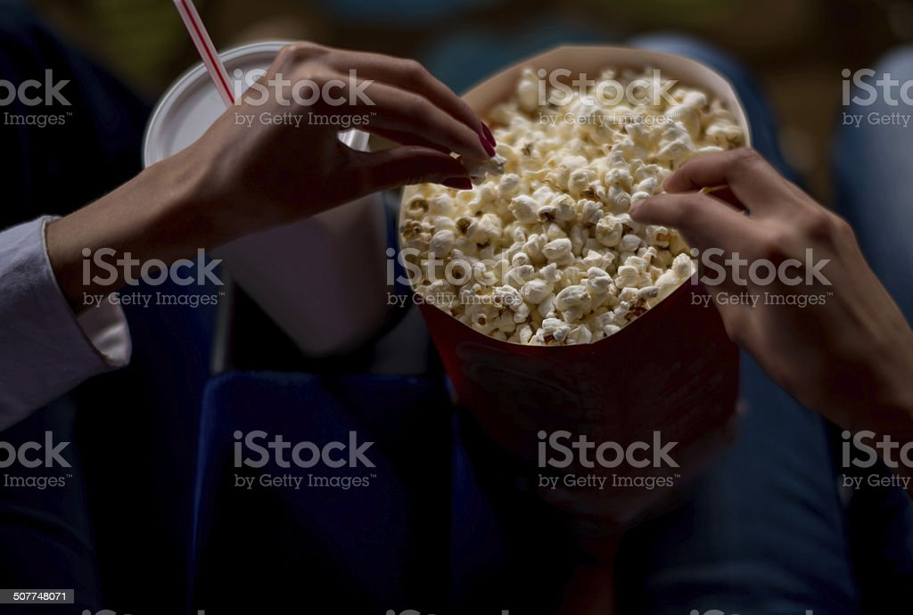 Eating popcorn at the movies stock photo