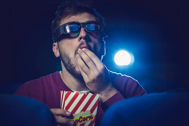 Manger pop-corn au cinéma - Photo