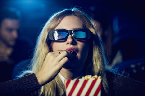Eating popcorn in movies stock photo