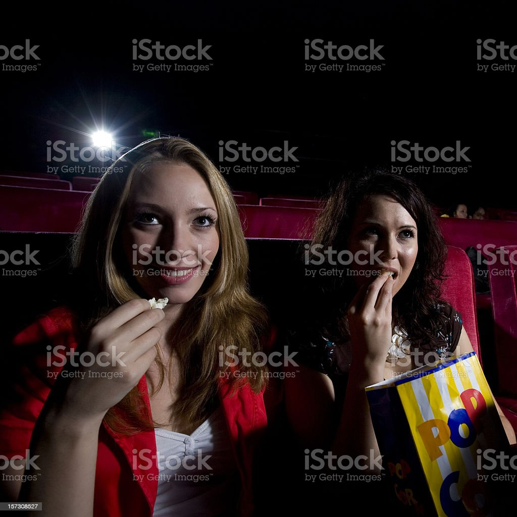 eating popcorn in the cinema stock photo