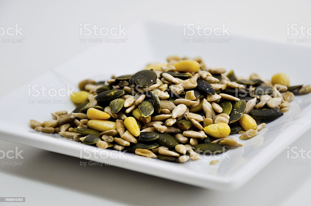 eating  pumpkin and sun flower seeds royalty-free stock photo