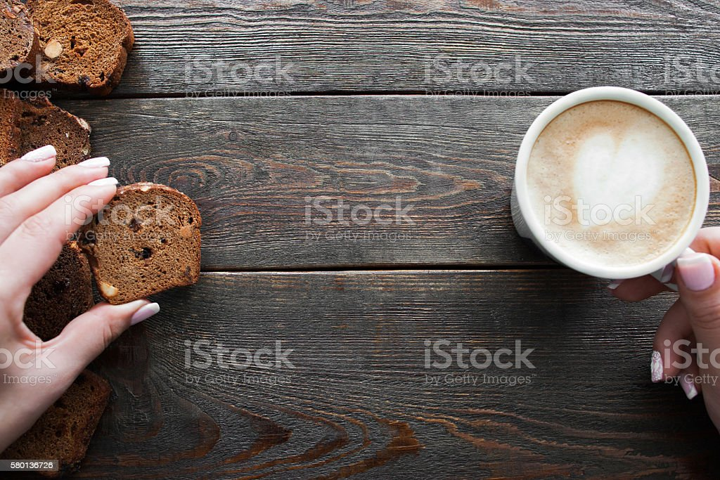 Eating rye bread with coffee, copyspace, wood stock photo