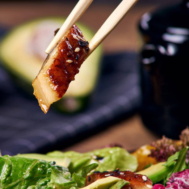 Eating Salad With Eel Stock Photo - Download Image Now - iStock