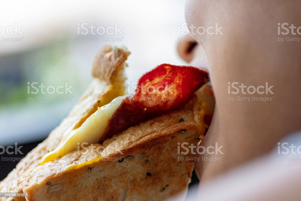 Eating sandwich stock photo