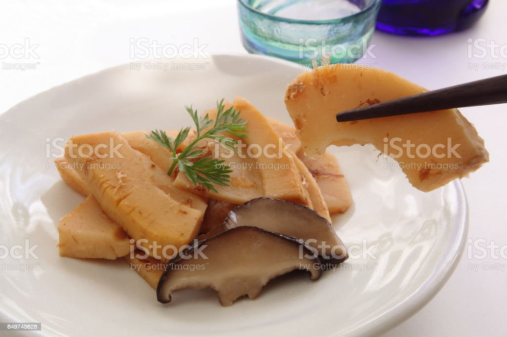 Eating Simmered Bamboo Shoots with chopsticks and Sake, Japanese Food stock photo