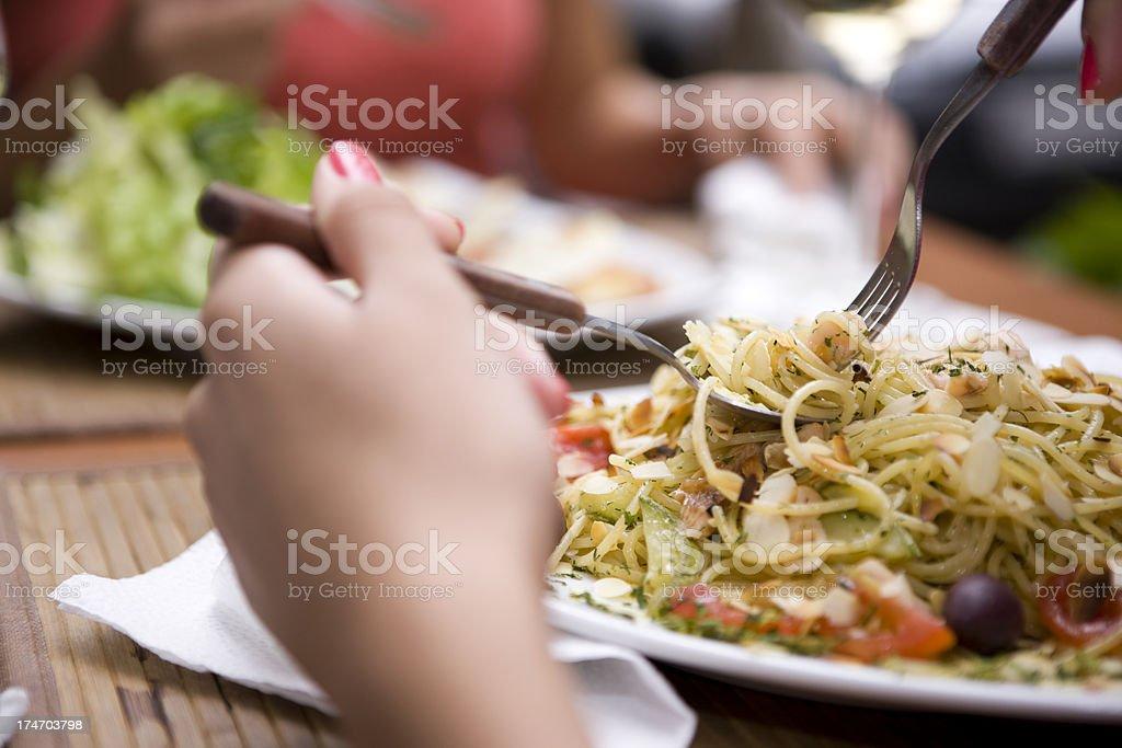 Eating spaghetti stock photo