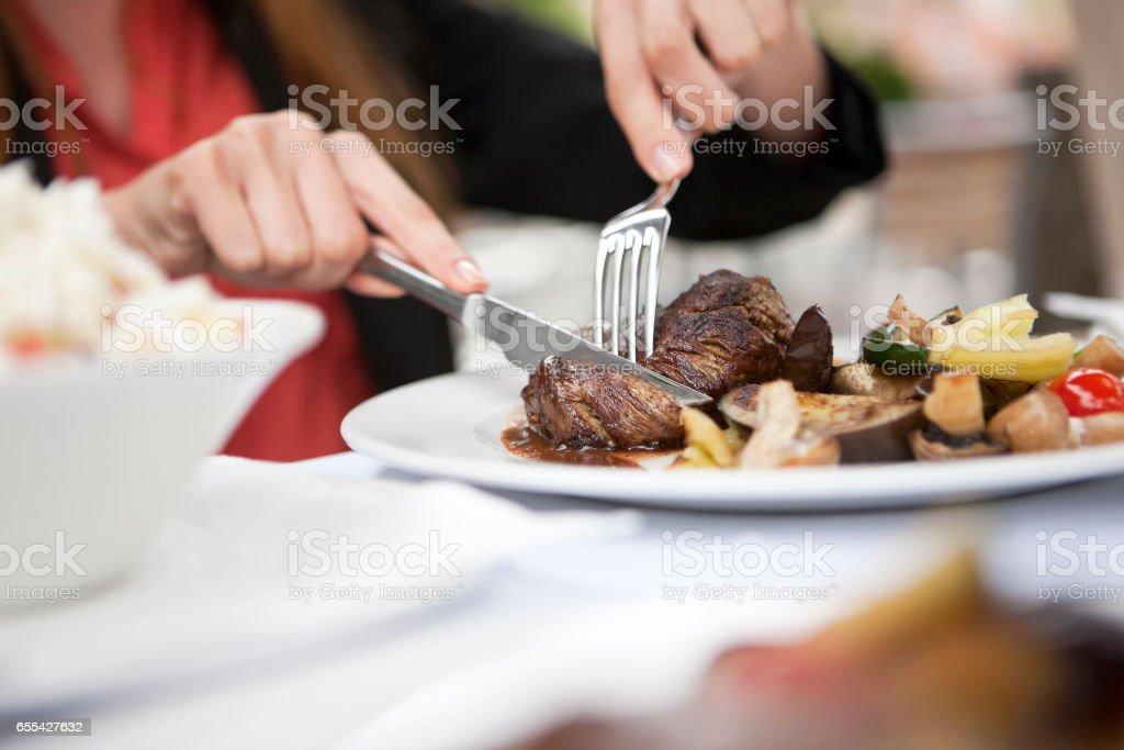 Eating steak stock photo