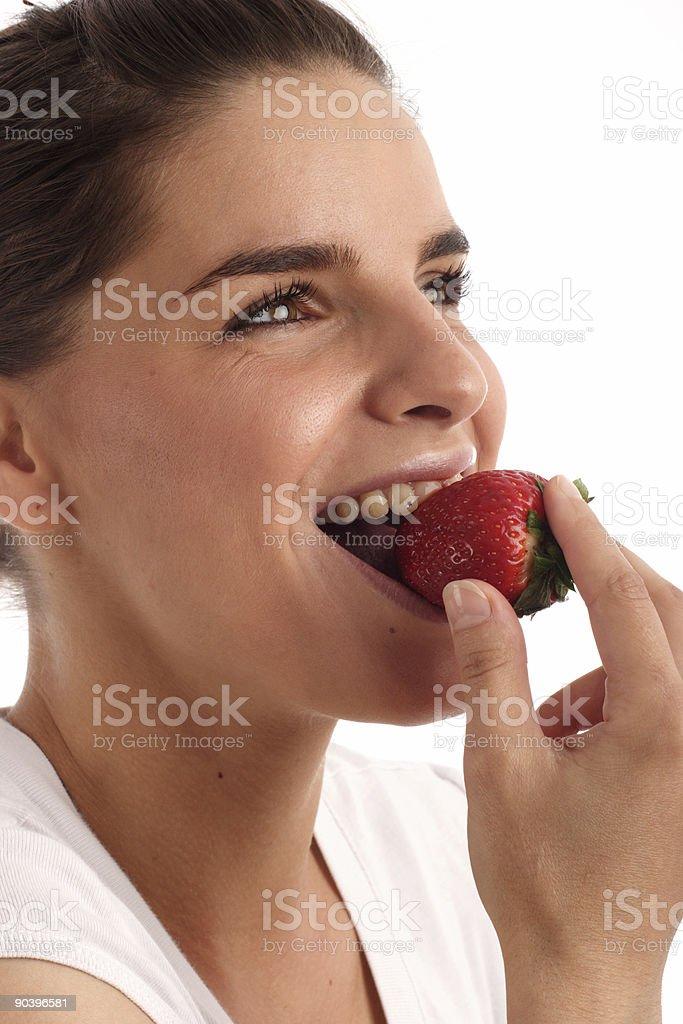 Eating strawberry stock photo