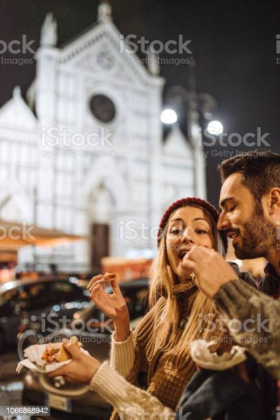 Eating street food at the christmas markets in italy picture id1066868942?b=1&k=6&m=1066868942&s=612x612&h=jvbczdxihxuxwiib1kqoci5 dnrpiqobqdxhgrfymmy=