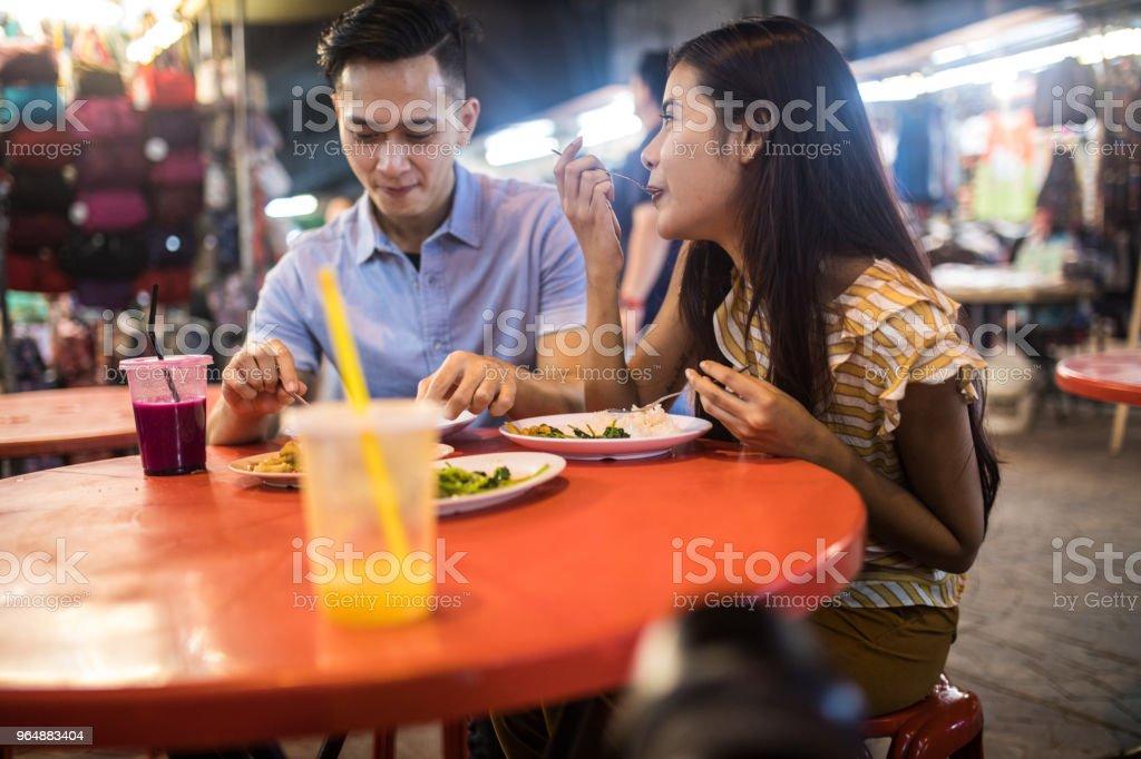 Eating street food at the Jalan Petaling market royalty-free stock photo