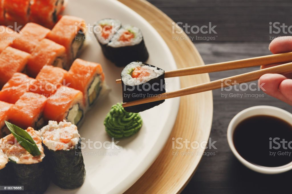 Eating sushi and rolls in japanese restaurant stock photo