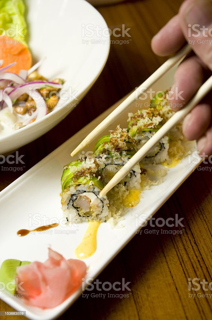Eating Sushi Dinner With Chopsticks royalty-free stock photo