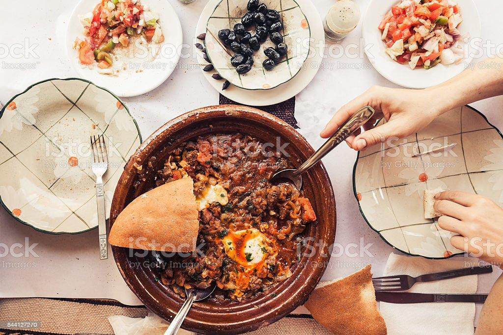 Eating tajine in Erfoud Morocco stock photo