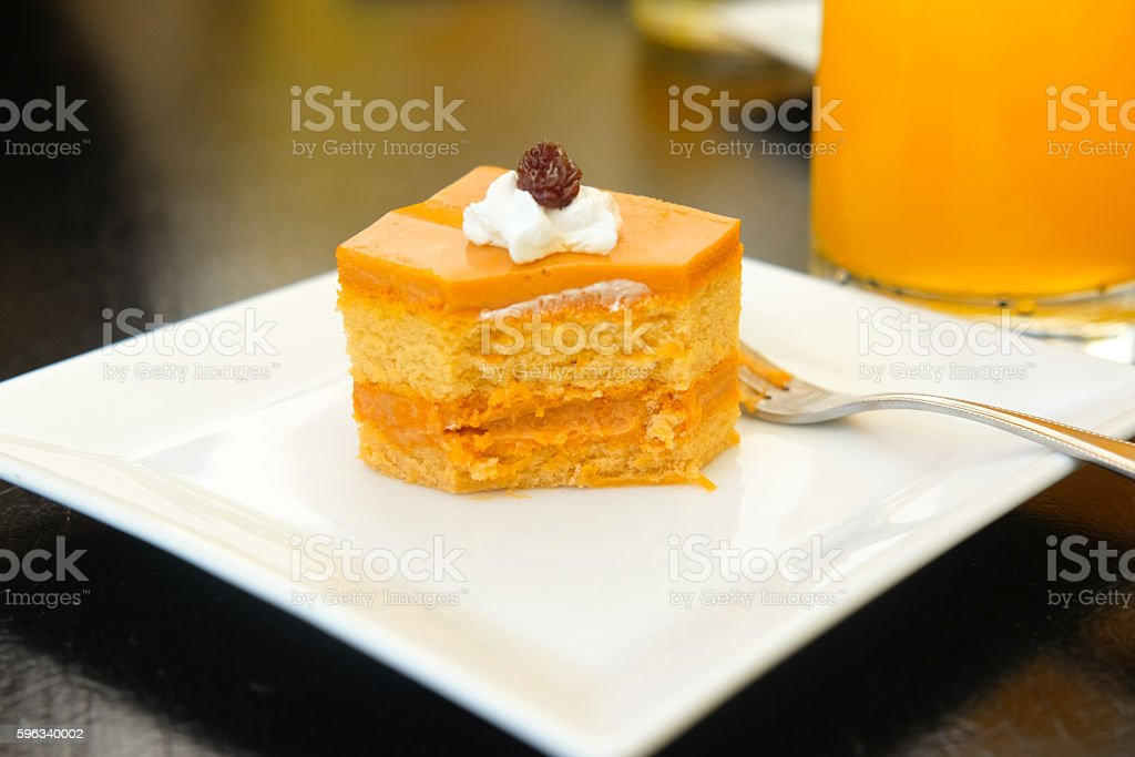 Eating Thai tea layer cake with mold royalty-free stock photo
