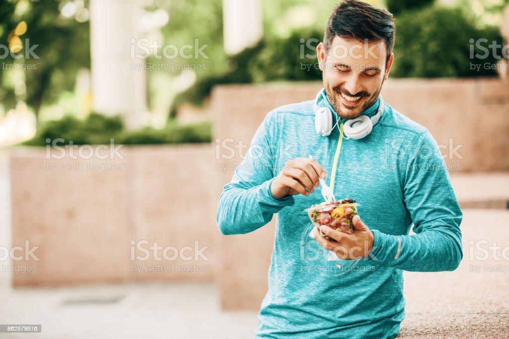 Eating vegetable salad stock photo