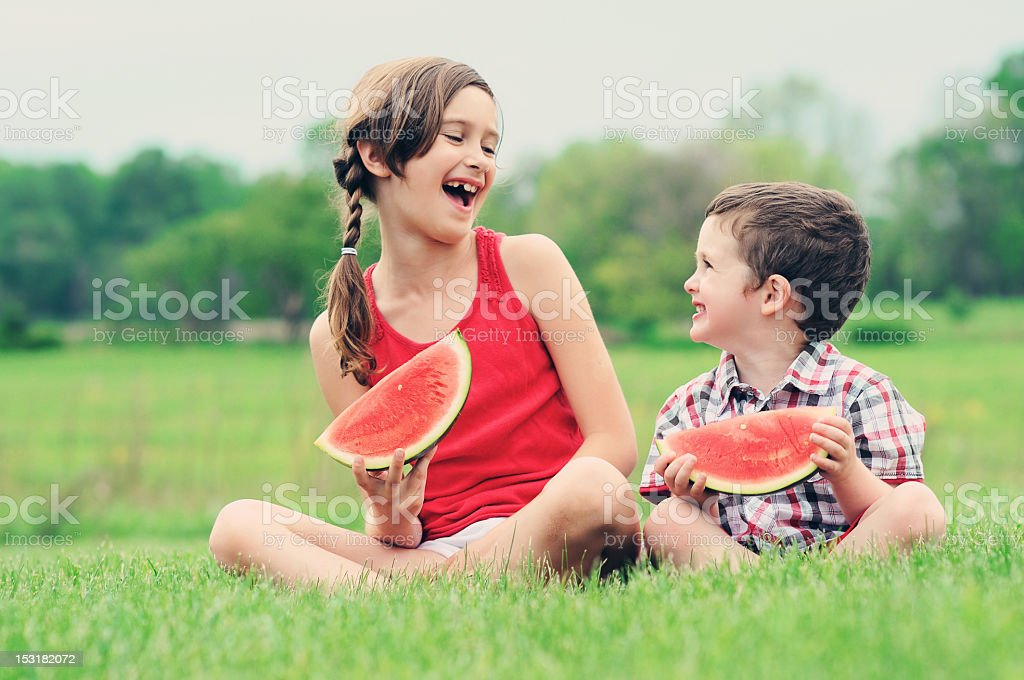 Eating watermelon in the grass royalty-free stock photo