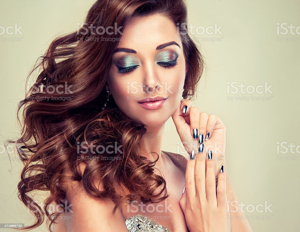 eautiful model with long curly hair stock photo