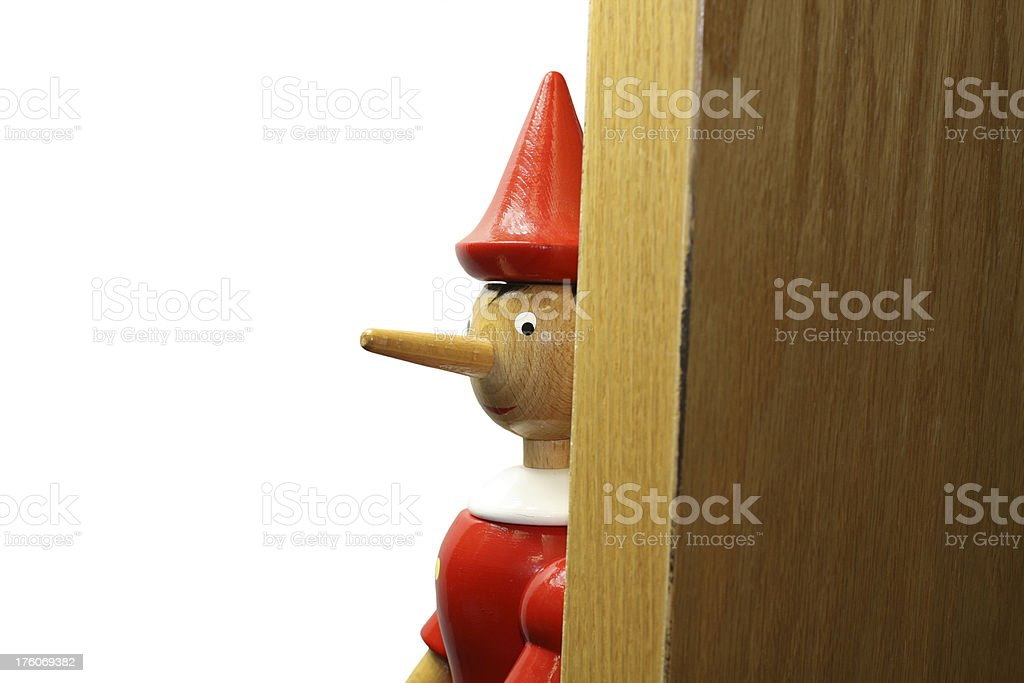 Eavesdropping Pinocchio stock photo