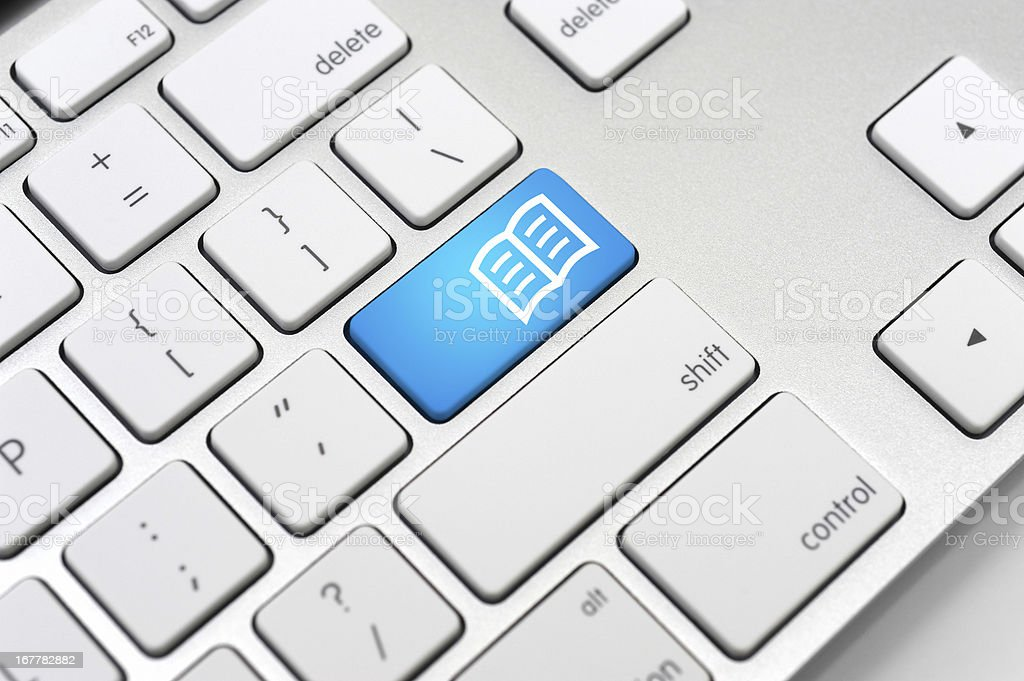 eBook Icon On Computer Keyboard-Learning Concept stock photo