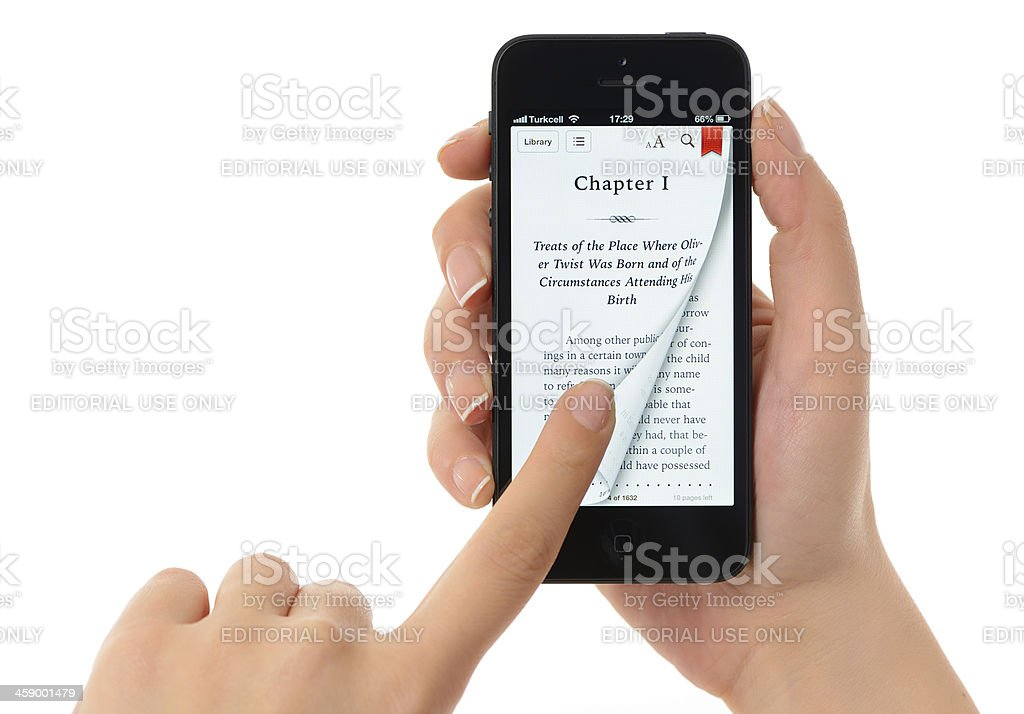 E-book on iPhone 5 royalty-free stock photo