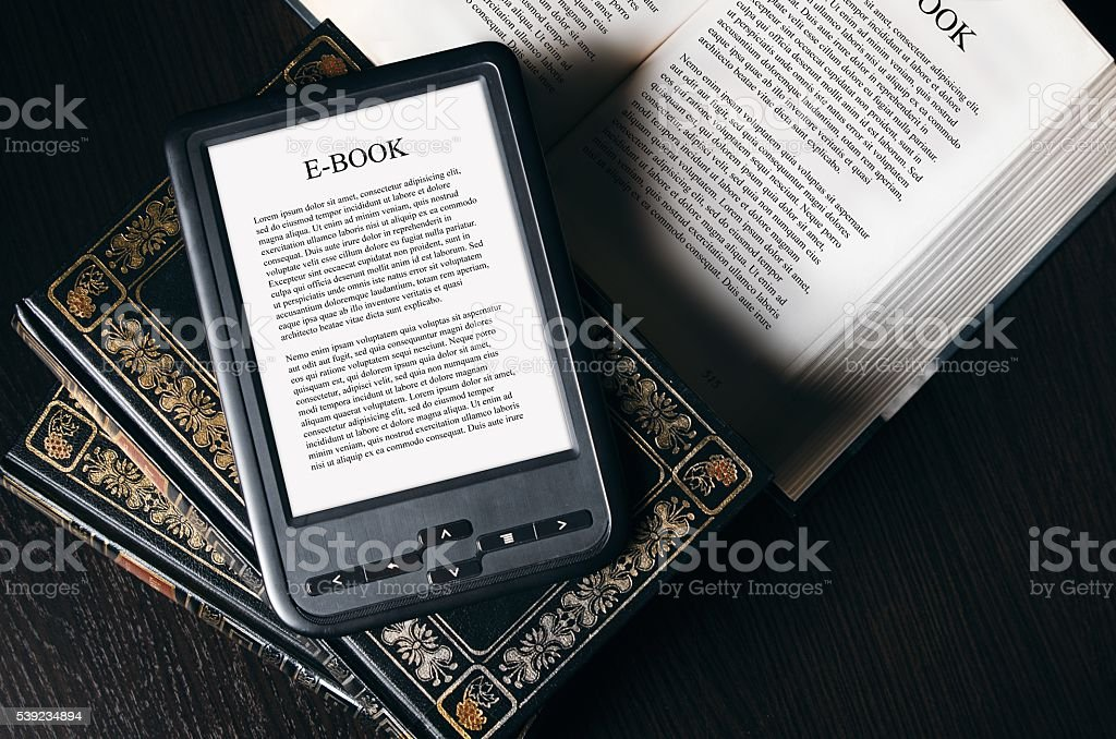 E-book reader device on desk in library royalty-free stock photo