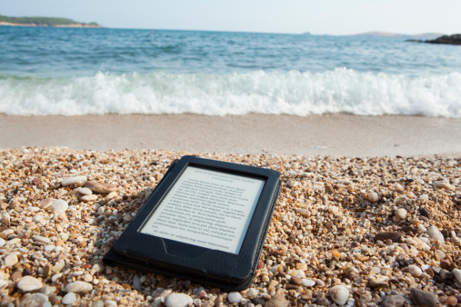 Ebook Reader On A Beach With Lorem Ipsum Text Stock Photo - Download Image Now
