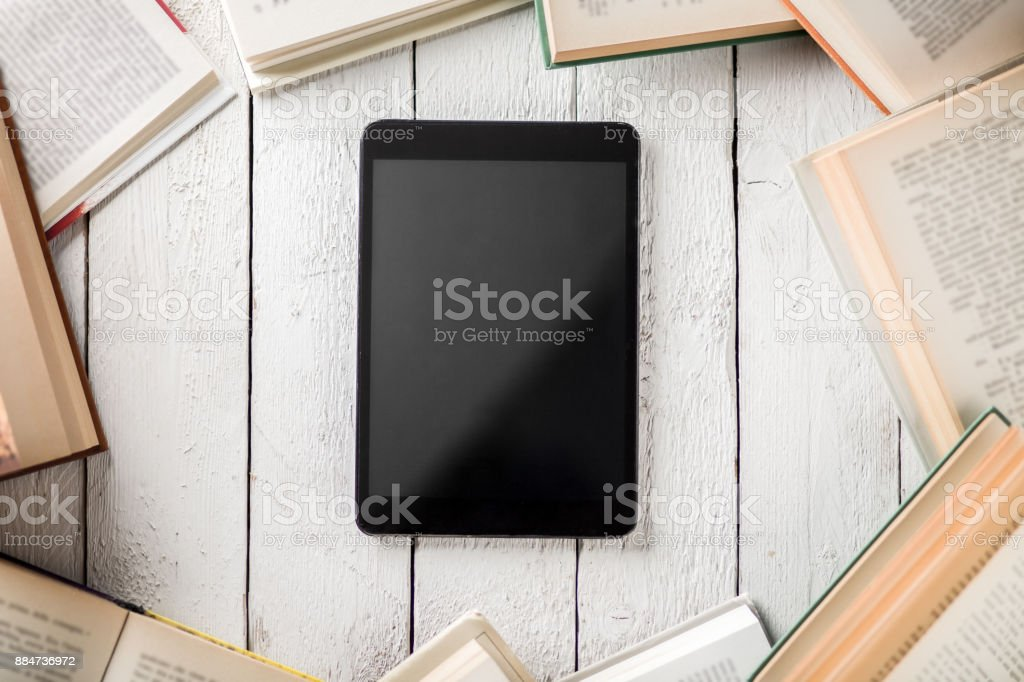 Ebook Reader with Books stock photo