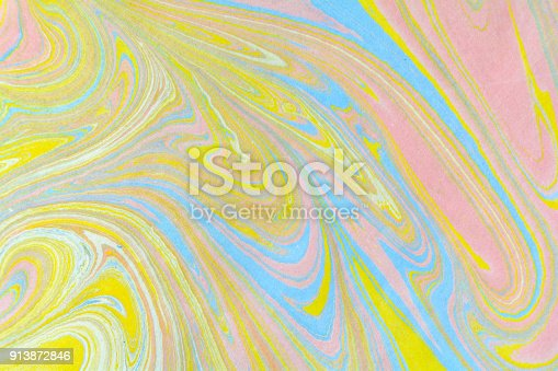 937715106istockphoto Ebru art. Traditional Turkish Ebru technique. Marbling painting on water transferred on highly textured paper or cloth. Color paint ebru with waves and tile pattern. 913872846