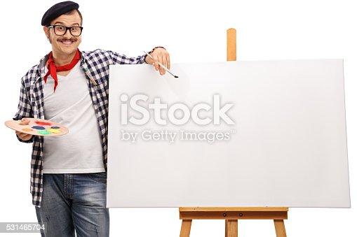 istock Eccentric artist posing next to a canvas 531465704