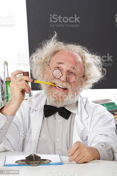Eccentric Scientist In Lab Thinks Of Ideas Stock Photo - Download Image Now