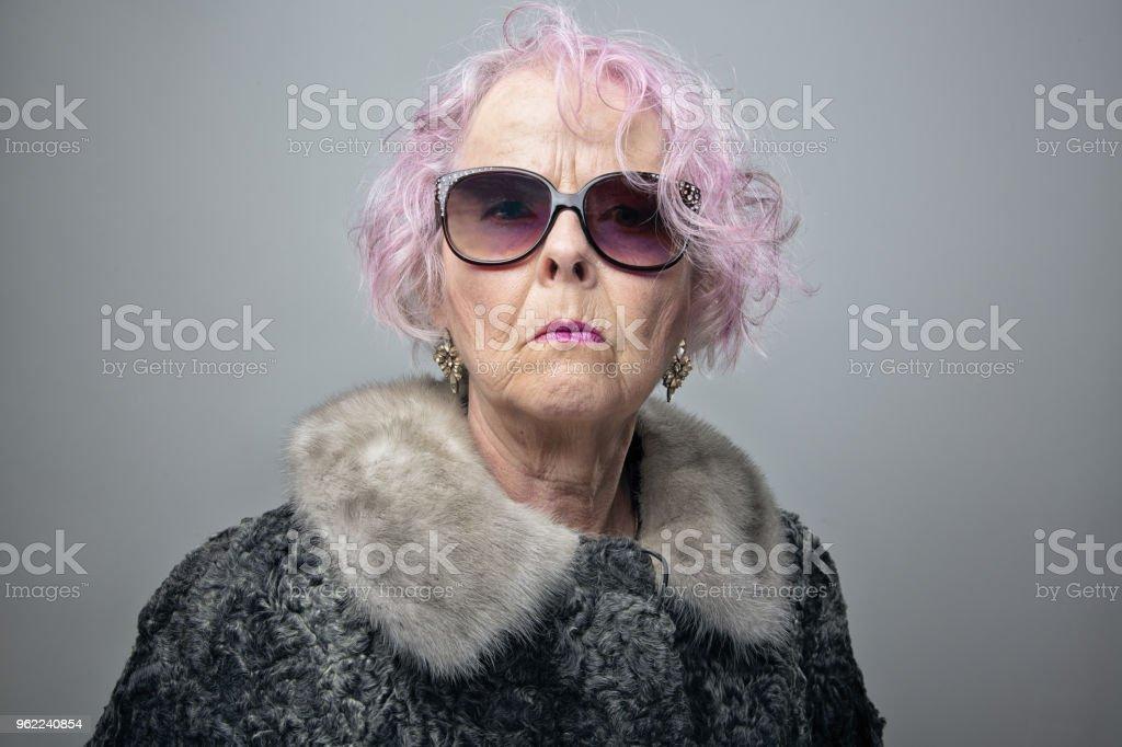 eccentric senior lady with cool attitude portrait stock photo