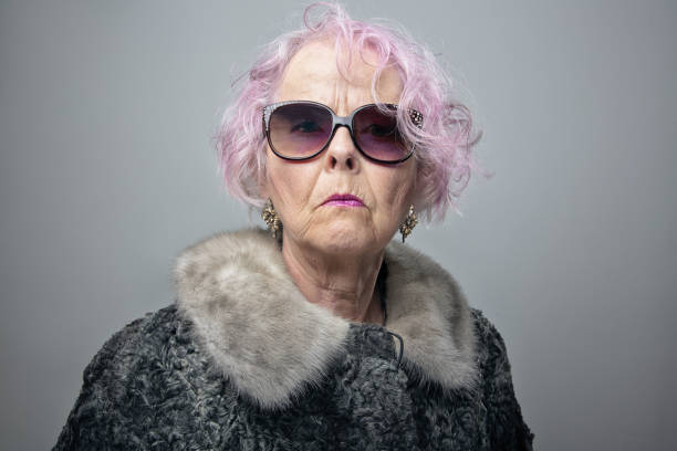 eccentric senior lady with cool attitude portrait stock photo