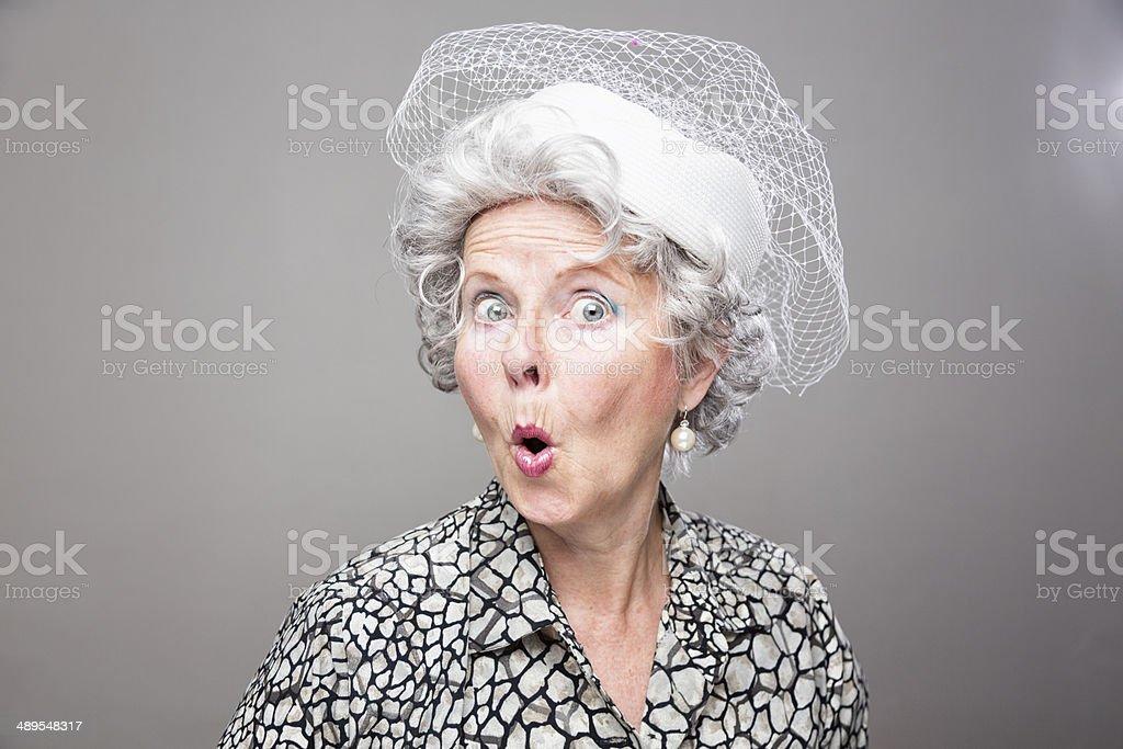 eccentric senior woman retro style surprise stock photo