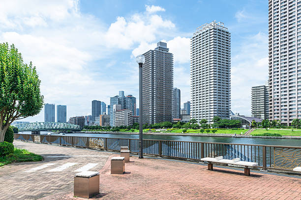 ecchujima park along the canal and the tower apartment - 広場 ストックフォトと画像