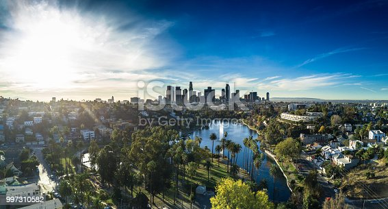Aerial panorama of Echo Park Lake in Los Angeles, surrounded by the neighborhood that bears its name, with the Downtown LA skyline in the distance.