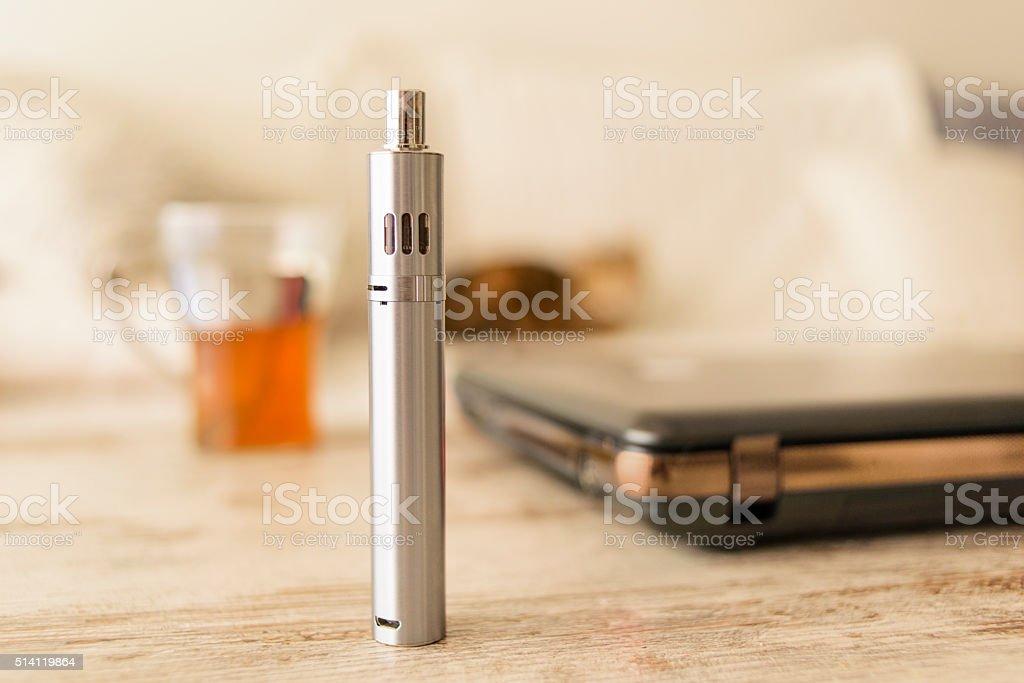 E-Cigarette Standing on a Table, Domestic Setting stock photo