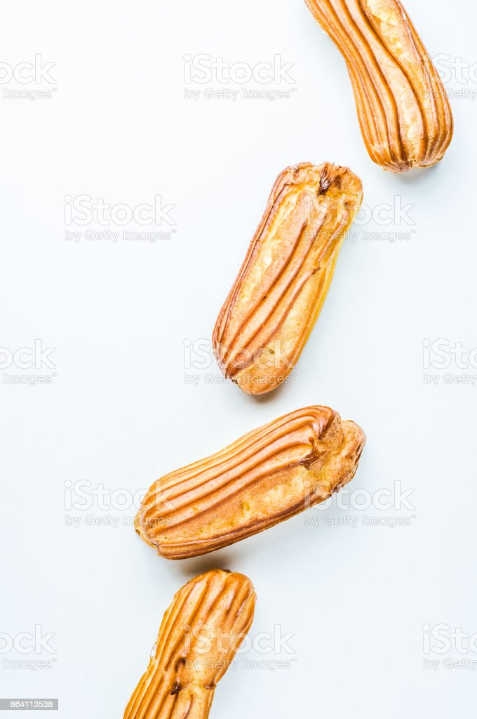 Eclairs on a white background royalty-free stock photo