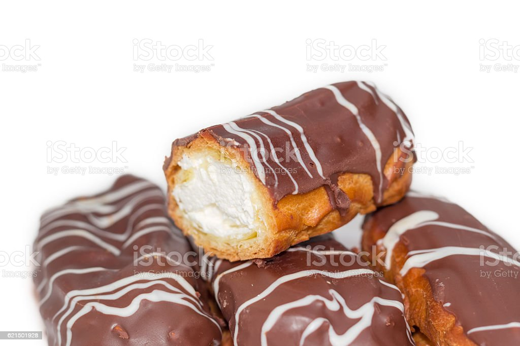 Eclairs with whipped cream and chocolate icing closeup photo libre de droits