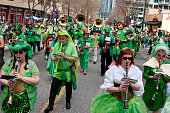 Atlanta, GA, USA - March 15, 2014:  A band dressed in eclectic green costumes plays while marching in the St. Patrick's parade down Peachtree Street.