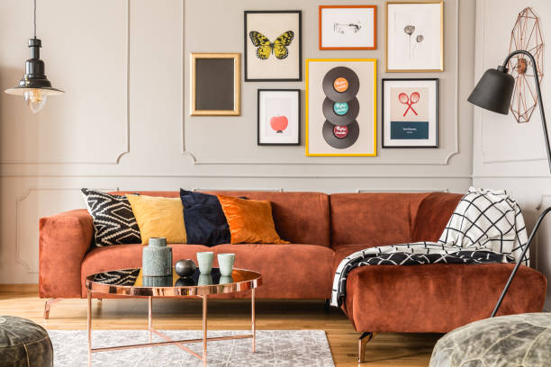 Eclectic living room interior with comfortable velvet corner sofa with pillows Eclectic living room interior with comfortable velvet corner sofa with pillows home decor stock pictures, royalty-free photos & images