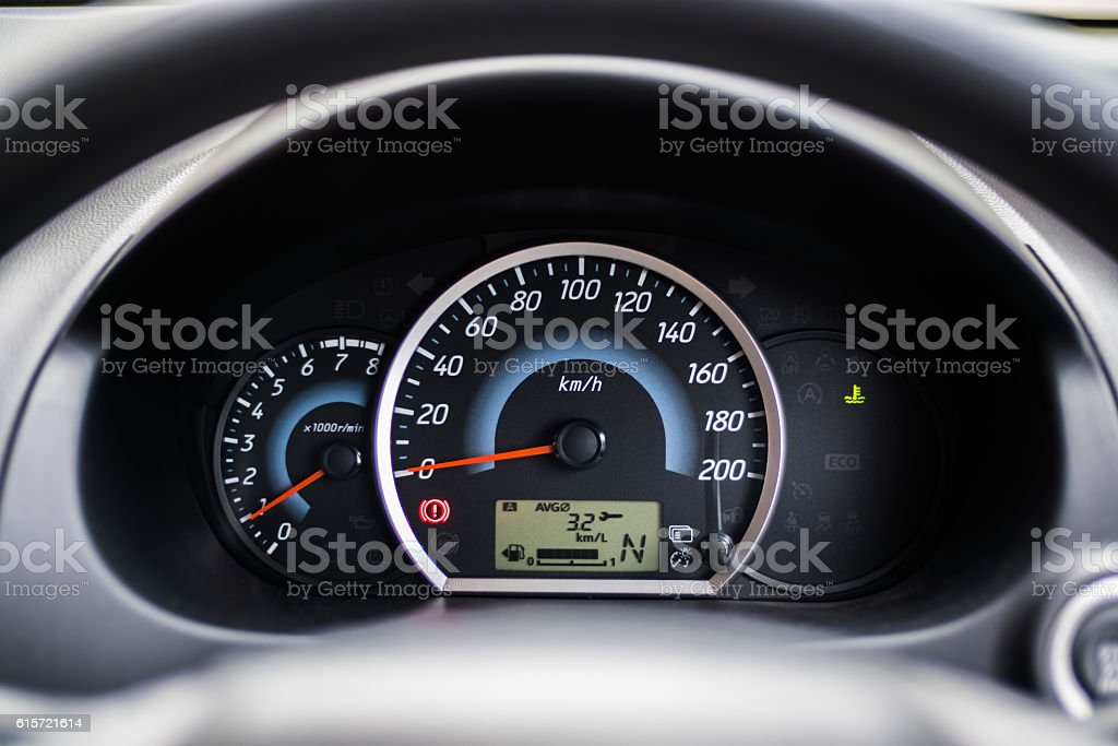 Eco car instrument cluster show kilometers per liter stock photo