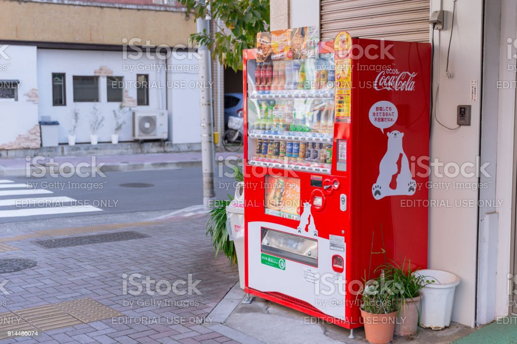 Eco Coca-Cola red vending machines sell beverage products with cute polar bear mascot found around Osaka Japan December 2017. stock photo