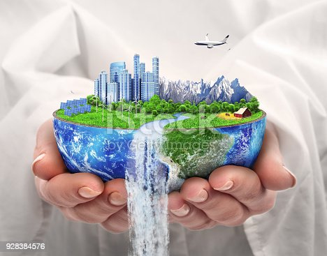 istock Eco concept. City of future. Solar energy town, wind energy. Save the planet. Earth Day. 928384576