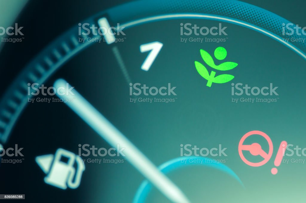 Eco drive light icon on car dashboard. stock photo