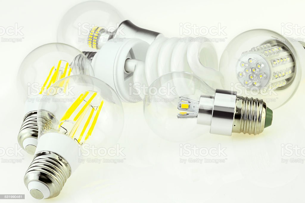 eco E27 bulbs with different LED chips and CFL bulb stock photo