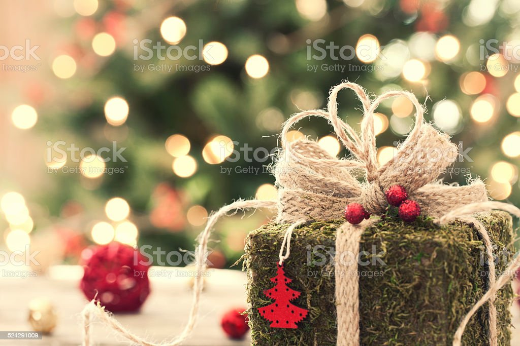 Eco environmentally friendly, holiday christmas moss gift on rustic...
