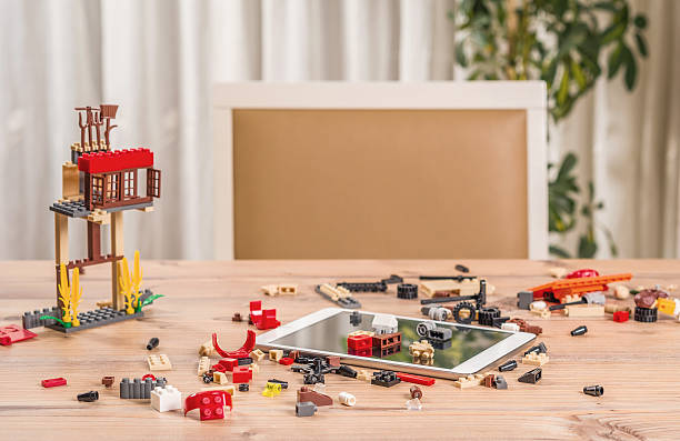eco farm lego toys  and dıgıtal tablet on the table - lego house stock photos and pictures