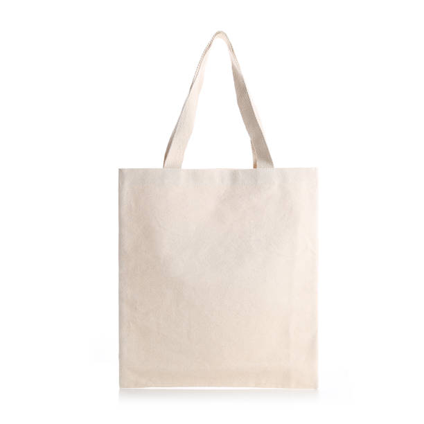 eco vriendelijke beige kleur fashion doek tote tas - boodschappentas tas stockfoto's en -beelden