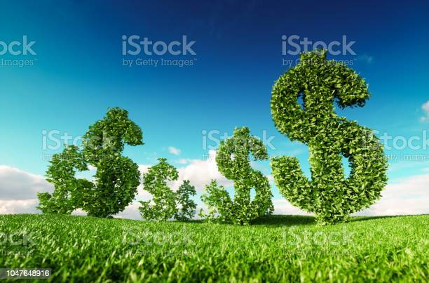 Photo of Eco friendly business, green profit, growing money and  sustainable economy concept. 3d rendering of green dollar icon on fresh spring meadow with blue sky in background.